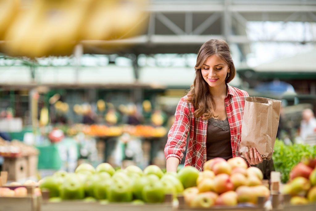 shopping woman buying fruit at the market